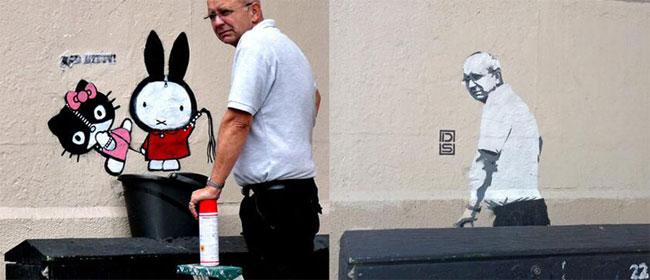 Grafit službenika koji briše grafite