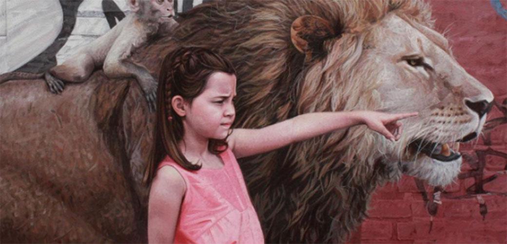 Slika: Devojčica i opasne životinje